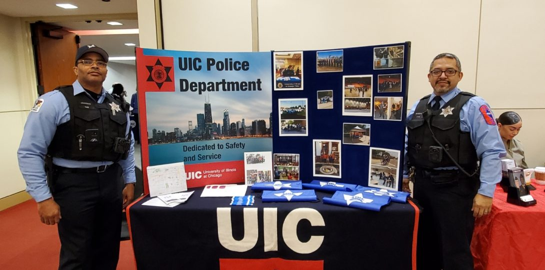 UIC PD posterboard with an officer on either side