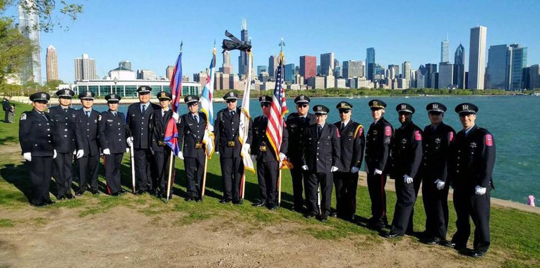 Full honor guard on the shore of Lake Michigan with flags