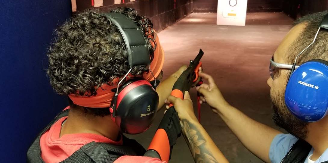 Intern on shooting range firing weapon