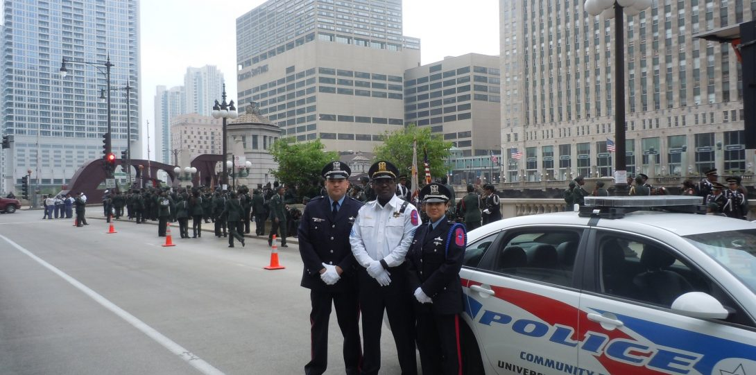 Honor guard members next to UIC PD vehicle
