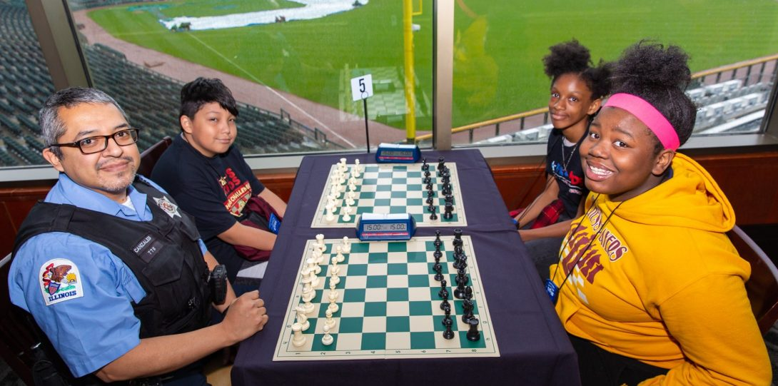 Office Canizales playing Chess with young people