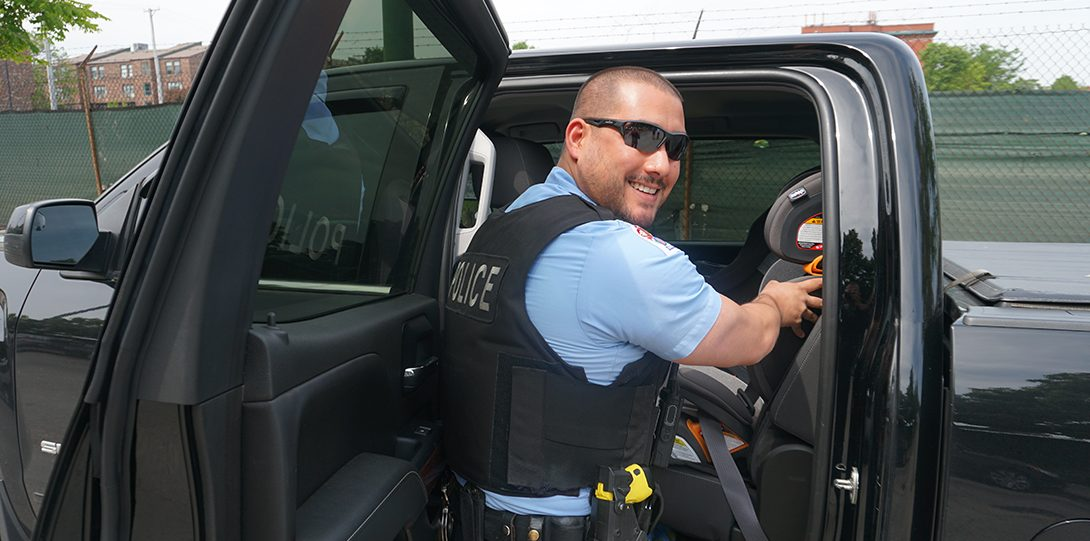Officer installing carseat