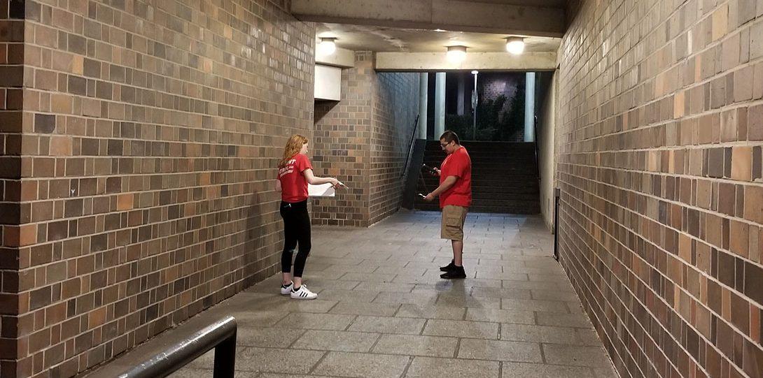 Student Patrol member conducting light survey inside of building on campus