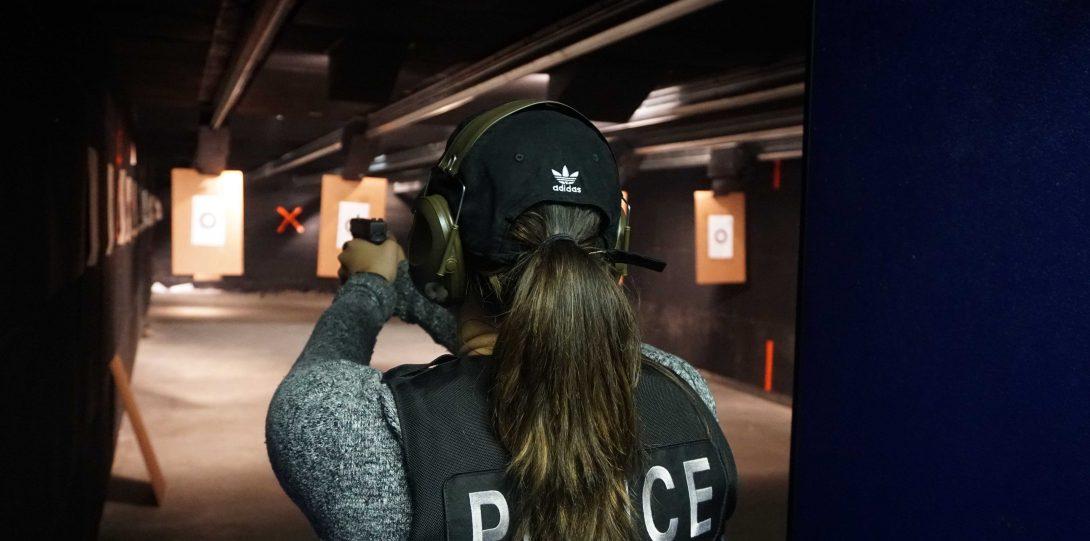 Female office on range with hand gun