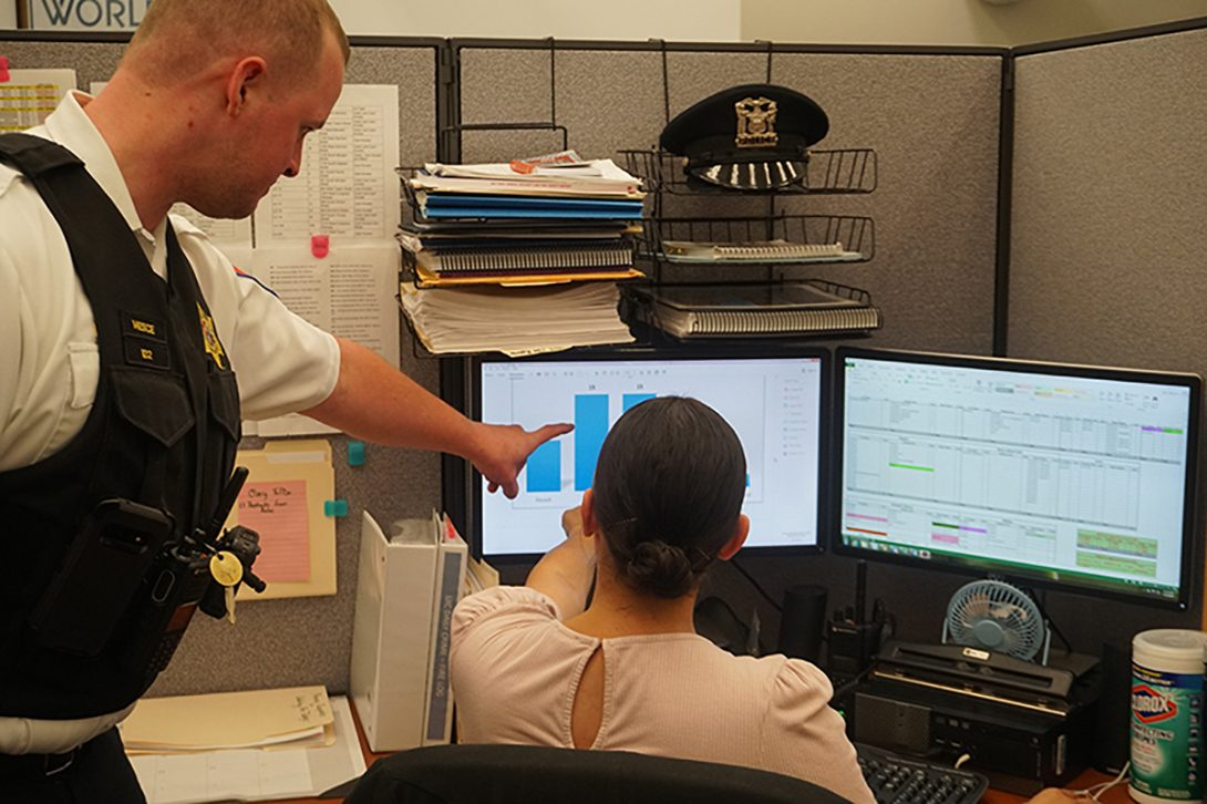 Two UIC PD staff members looking at crime statistics