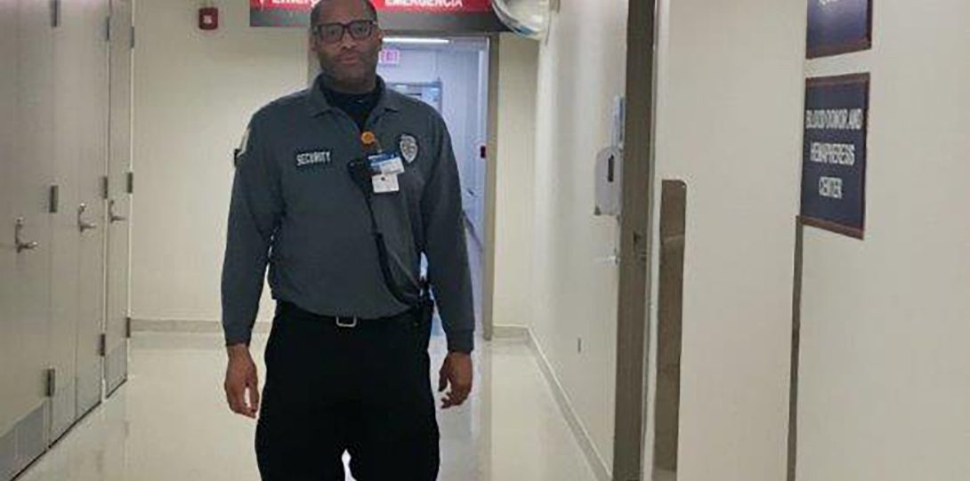 Security officer walking in hallway