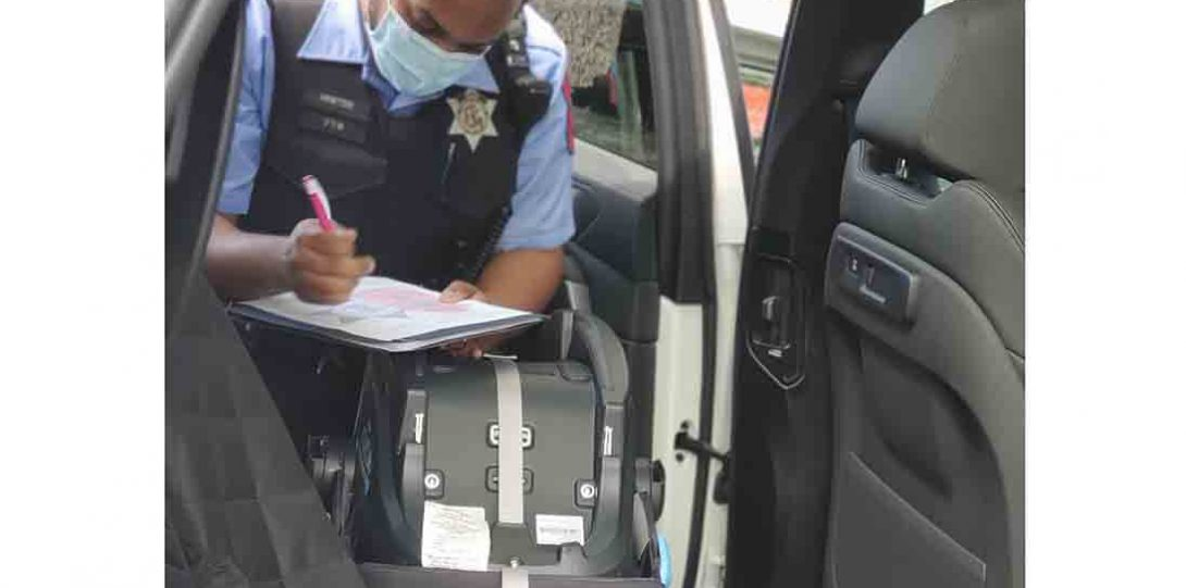 Officer documenting carseat installation