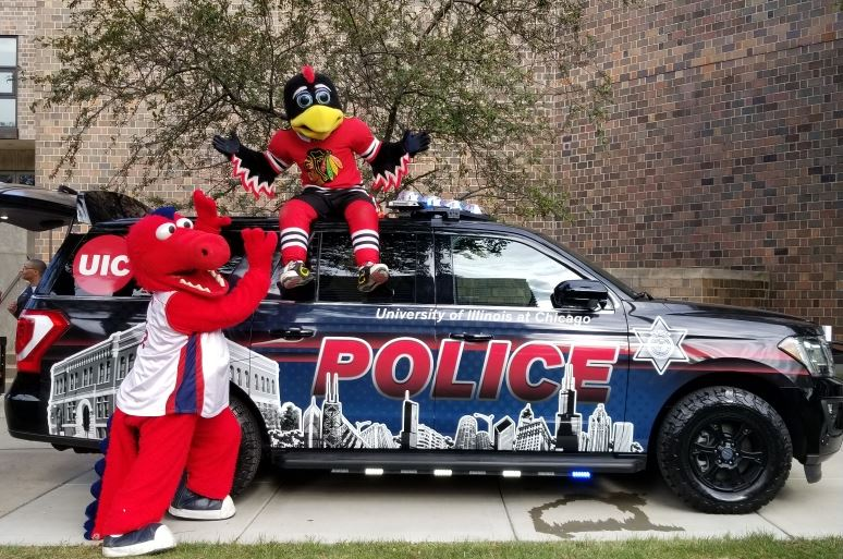 UIC PD vehicle with Sparky D. Dragon and Black Hawk